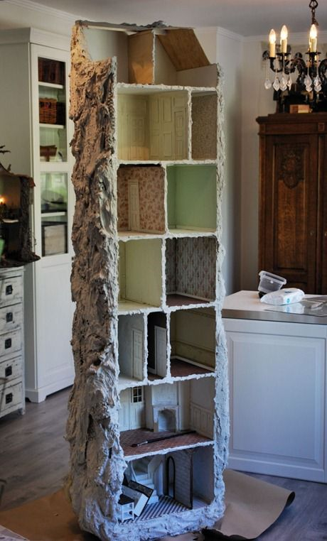I've been noodling on how to create vertical space for some of my miniatures, but don't want to use one of my bookcases, so this is very interesting.  Could be constructed out of a combo of wood and foamcore