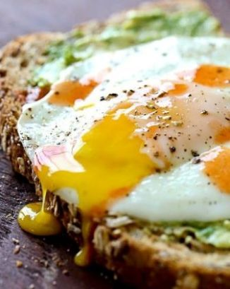 Avocado Toast with Sunny Side Egg—perfect healthy breakfast! This is something my player would love.. Small and simple on game morning!