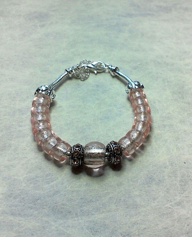 Pale pink silver lined Czech glass beads used to create a European style bracelet