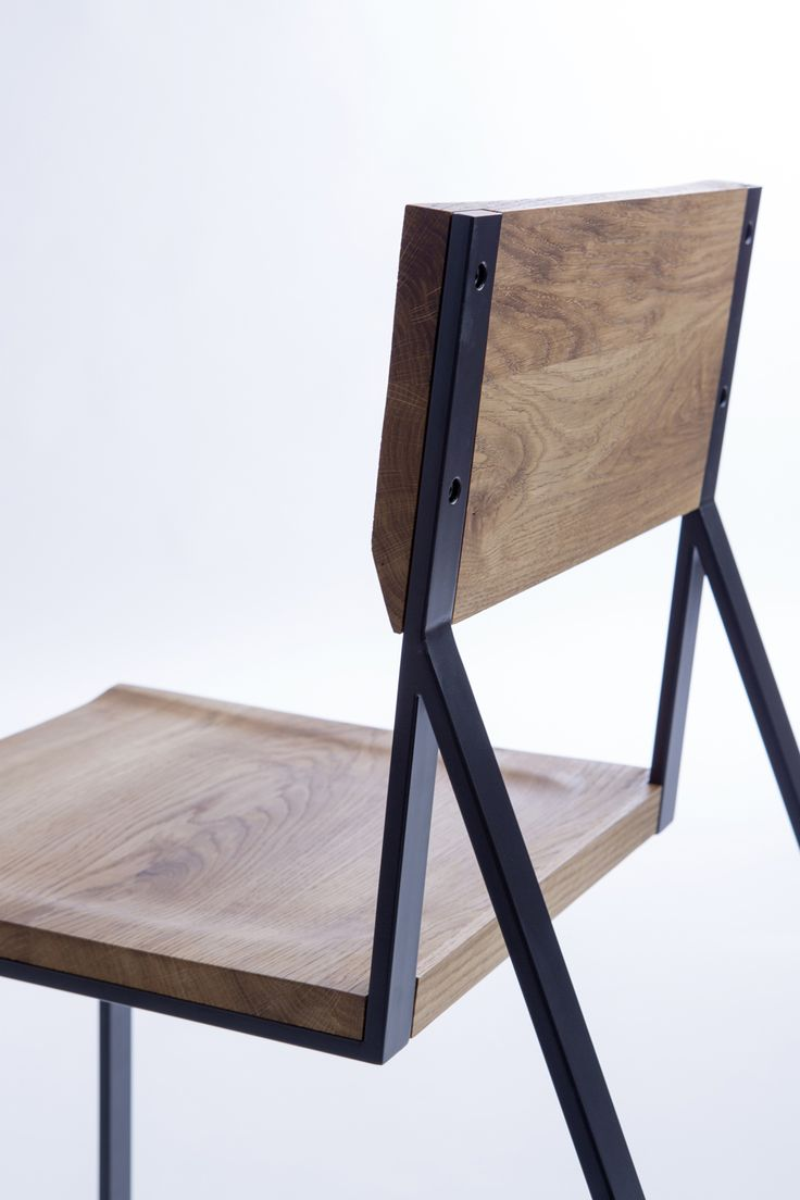 Sharp lines of a metal frame contrast with the natural grain of wood in K1.