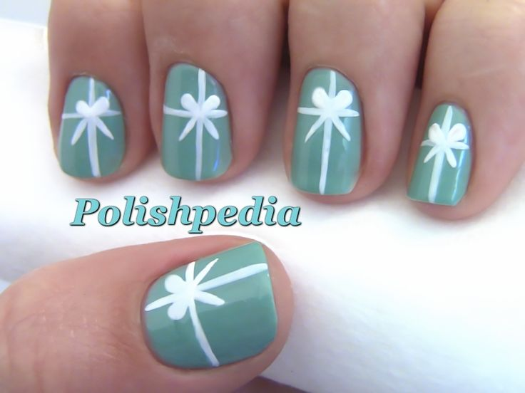 Tiffany's Christmas Present Nail Art - Has a video on the website