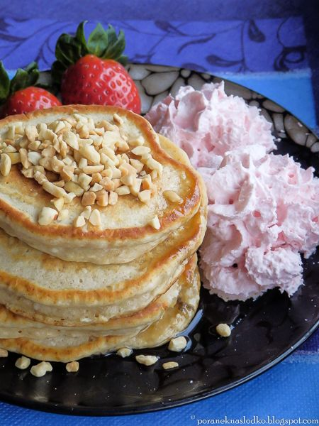 Triple coconut pancakes with strawberry whipped cream