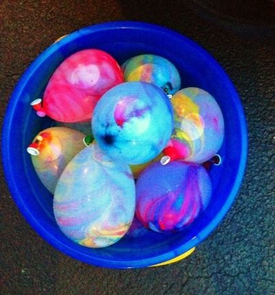 Water balloons with paint!!! Would SOO do this with like tie-dye or something with a white outfit on......... MUST DO!!