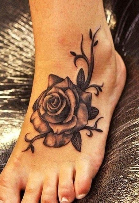 Women tattoos: Rose tattoo on foot