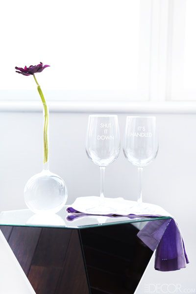 "Glasses for the girls... ""Scandal sent me these wine glasses. Etched on them are two phrases that Kerry Washington's character Olivia Pope says on the show. We have a lot in common!"" Flowers by Van Vliet and Trap.    - ELLEDecor.com"