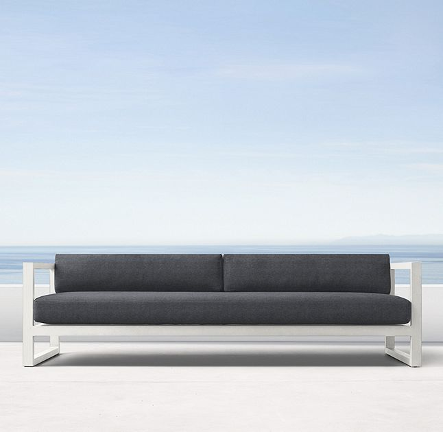 """RH's 93"""" Aegean Aluminum Sofa:Influenced by the low, linear silhouettes of seaside architecture, our contemporary collection is designed by a family-owned company in Australia known for its meticulous metalwork. Its superior materials and simple geometry enable it to weather the elements in enduring style."""