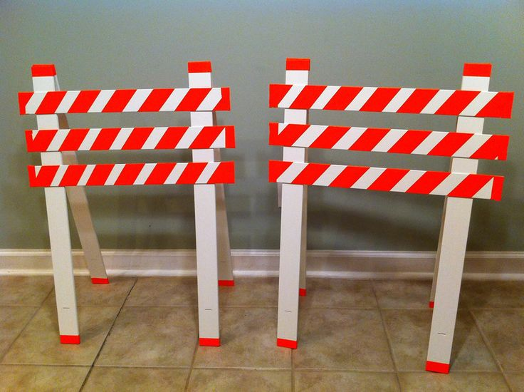 I made construction road signs from old window blinds and orange duct tape!