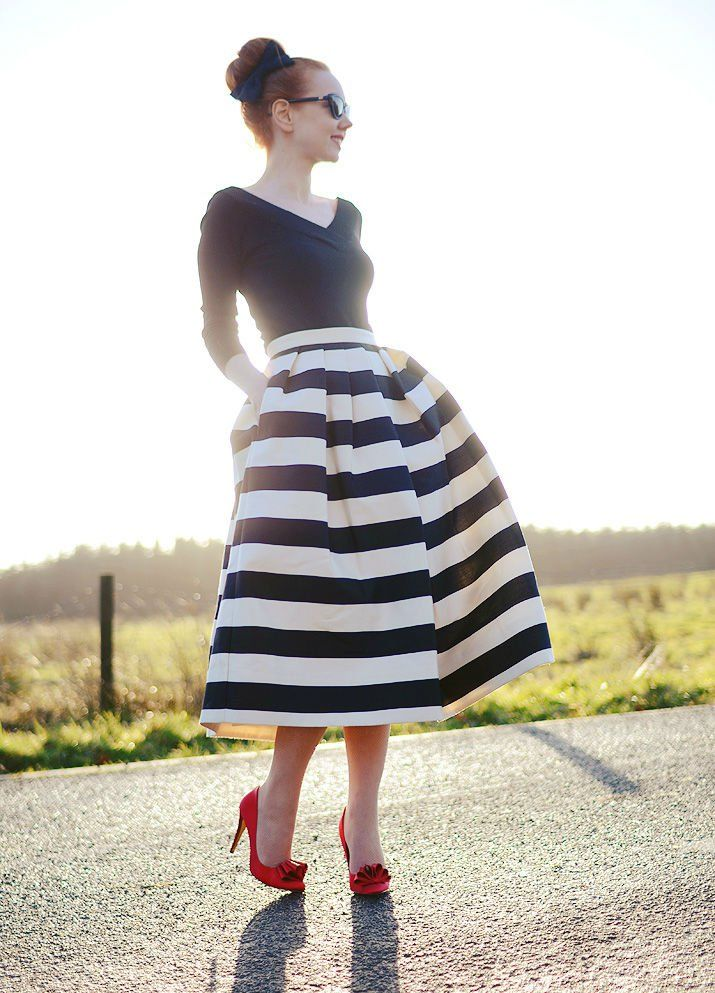 Stripped dress with stunning red shoes.