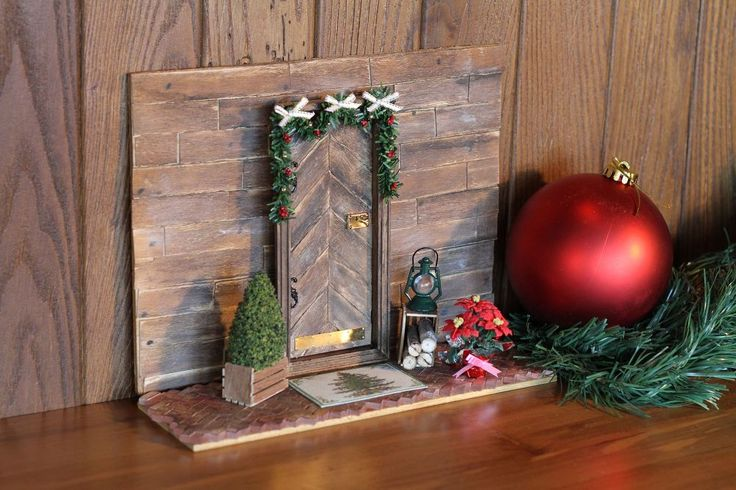 Using dollhouse doors, miniature scale accents and supplies from miniatures.com, we've created a warm and inviting Elf door for the elves that might visit from…