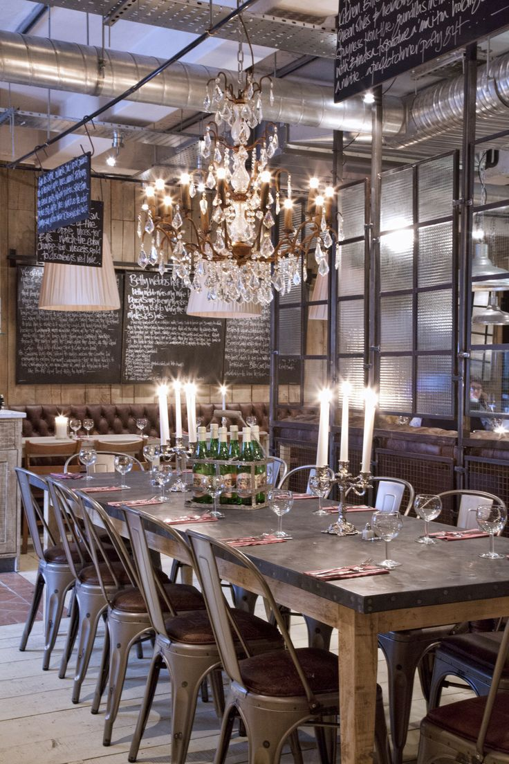 Restaurant Menu Boards, chandelier, chairs with table, windows to break up space