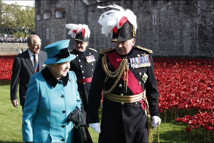 16 OCTOBER 2014 Queen Elizabeth and Prince Philip visits the Tower of London Queen Elizabeth II and Prince Philip, Duke of Edinburgh arrive to view The Blood Swept Lands and Seas of Red Poppies at The Tower of London on 16.10.2014 in London, England.