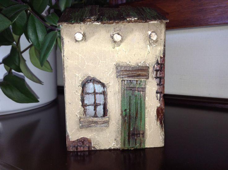 little wood adobe house