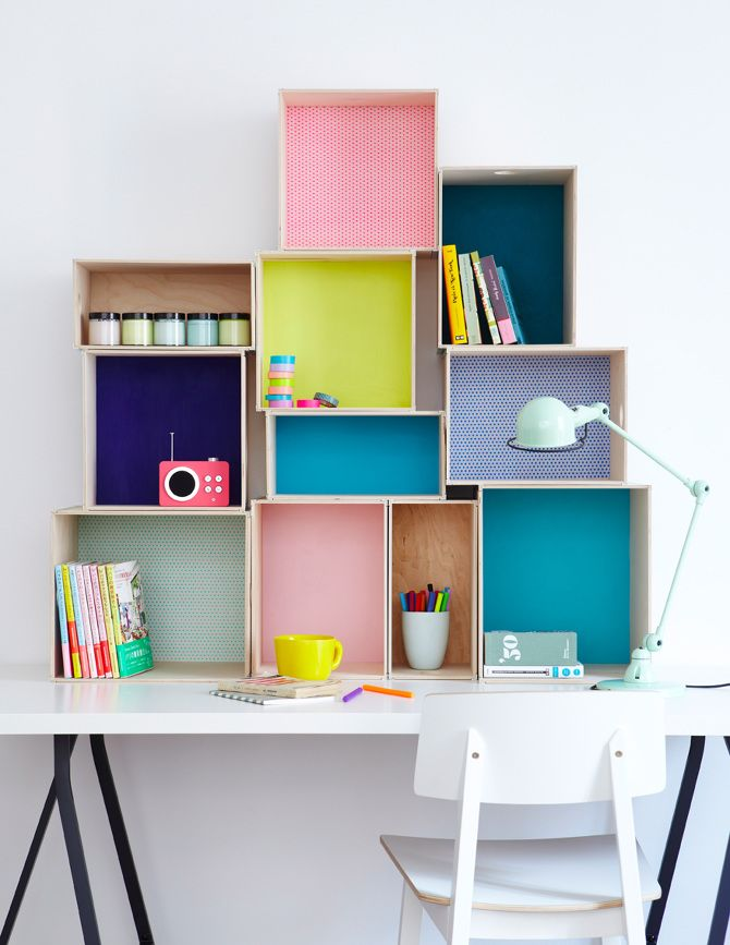Love the boxes and pops of colour above the desk