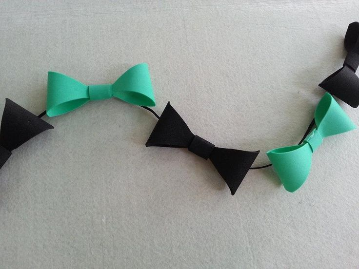 Use bowties to make a garland for a boy-themed party such as a baby shower. Materials paper glue string scissors