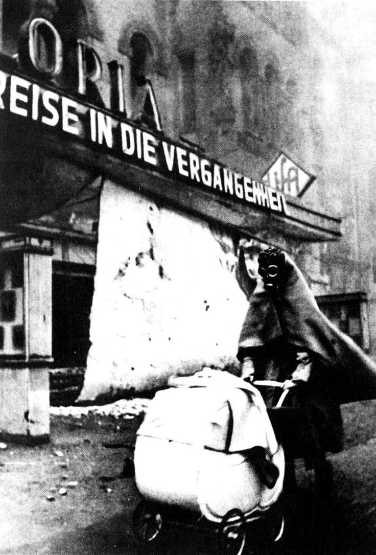 Frau mit Gasmaske, Berlin by Wolf Strache, 1943