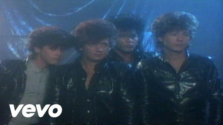 1983 - The Romantics - Talking in Your Sleep.  I bought the song without ever seeing the video.  Too bad, since it's so sensual.  And check out the hair, too!  Definitely the '80s, eh?