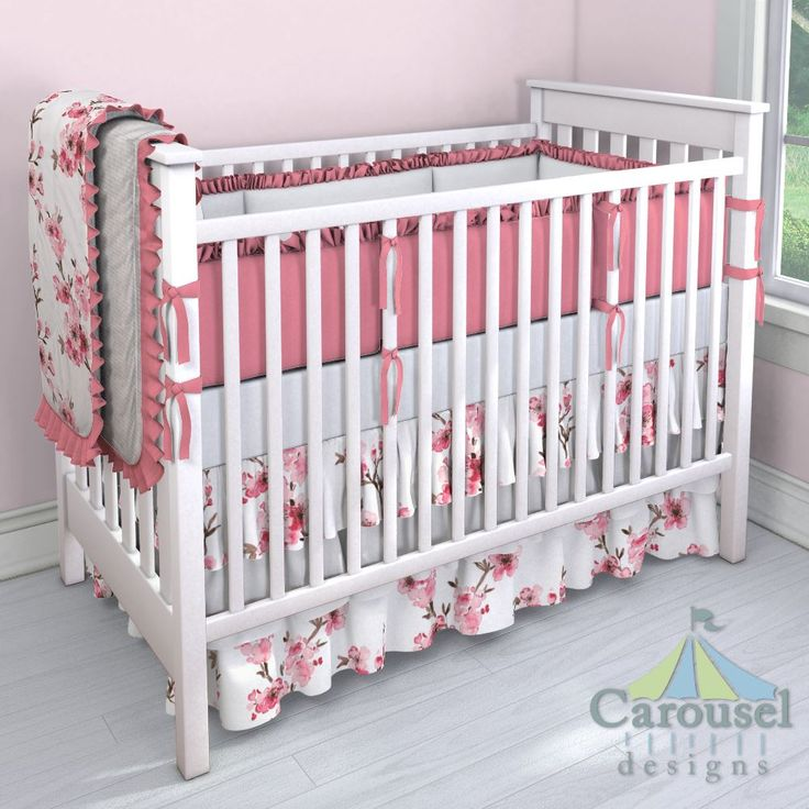 Crib bedding in Pink Cherry Blossom, Solid Antique White, Solid Almond Pink, Heartfelt. Created using the Nursery Designer® by Carousel Designs where you mix and match from hundreds of fabrics to create your own unique baby bedding. #carouseldesigns