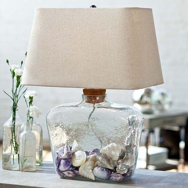 Uniquely shaped rectangle hand-blown wavey glass lamp with a cork top to make filling the base with your beach treasures easy!