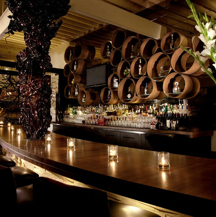 Red O Restaurant barrels behind bar.