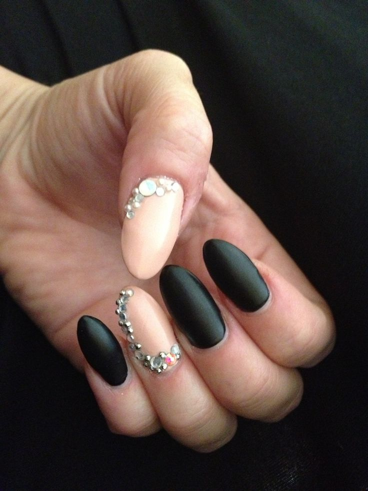 Matte black and pink rhinestone stiletto gel nail art. I would square them off and keep the stones to the top only