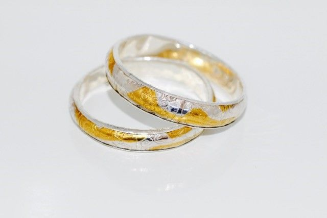 Fine Silver and Gold Patterned Anticlastic Bangles Jenny Whitmore