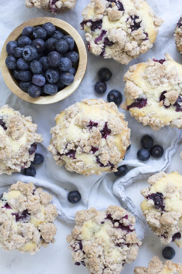Easy and delicious homemade blueberry muffins stuffed full of fresh blueberries and topped with a buttery cinnamon crumb topping.