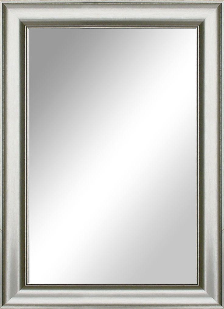 Spegel med silverfärgd ram.