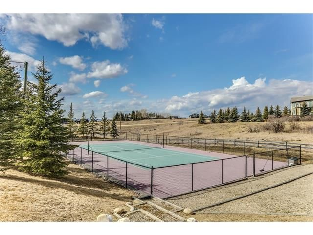 Tennis Anyone?  Amazing Beaspaw Acreage!!! Masterfully positioned to benefit the stunning unobstructed Rocky Mountains & rolling valley views, this executive 4 acre property offers a unique opportunity to own a tranquil and serene country home only minutes from Calgary & Cochrane.  #stevenhillsothebys