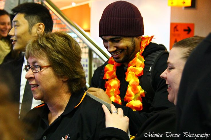 Southland Sharks Champions mingle with very proud and jubilant supporters at Invercargill Airport on July 15, 2013. See our story : http://iluvinvers.co.nz/an-orange-landing-southland-sharks/