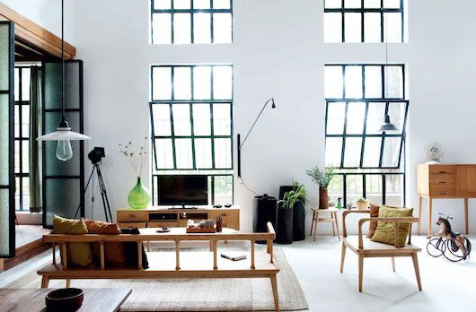 This Beijing home of furniture designer Gu Qi & his graphic designer girlfriend Mobai