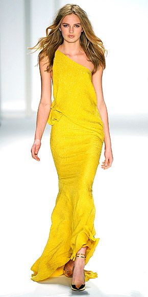 J. MENDEL    Though the J. Mendel collection had plenty of fall-appropriate black, designer Gilles Mendel gave the traditional looks a twist with plunging fronts, lots of winter white, plus the pop of unexpected colors – as in this elegantly cut yellow gown.