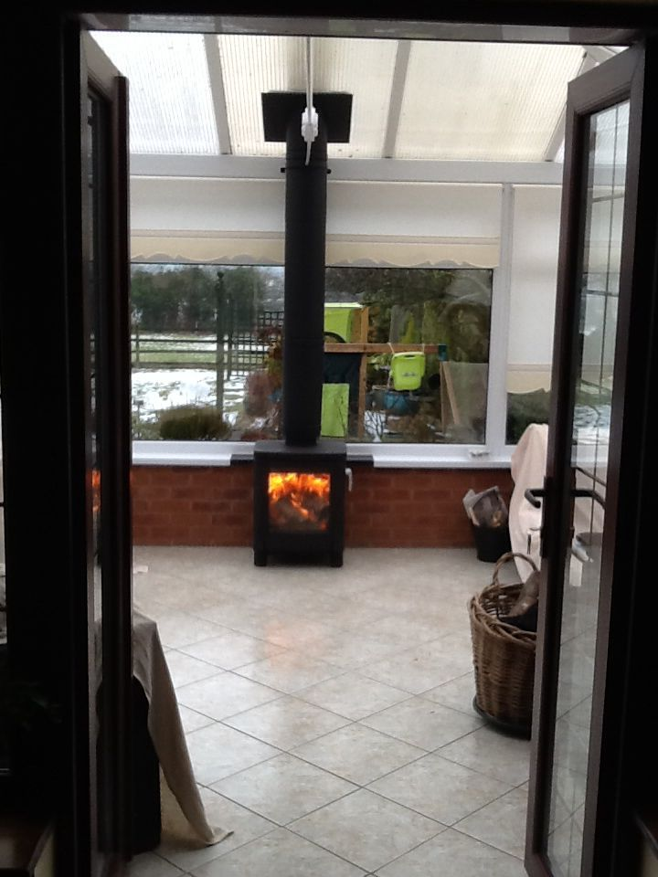 A Contura 51L in a conservatory. We've developed a custom-made bracket system that attaches to the dwarf wall and supports the flue tremendously well.