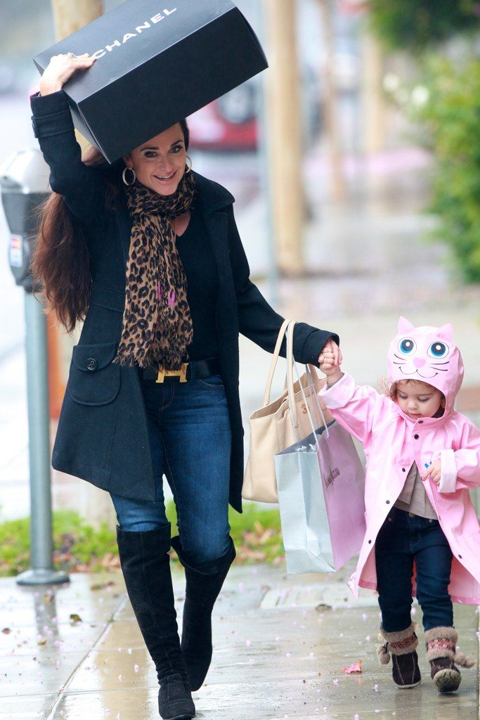Kyle Richards.  She really has it together.  Plus she has an adorable family and is using a Chanel shopping bag as an umbrella.  What's not to love?