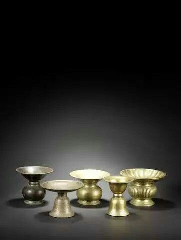 Lot 130  Five small brass Spittoons India, 16th-18th Century(5)  Sold for £312 (INR 29,886) inc. premium