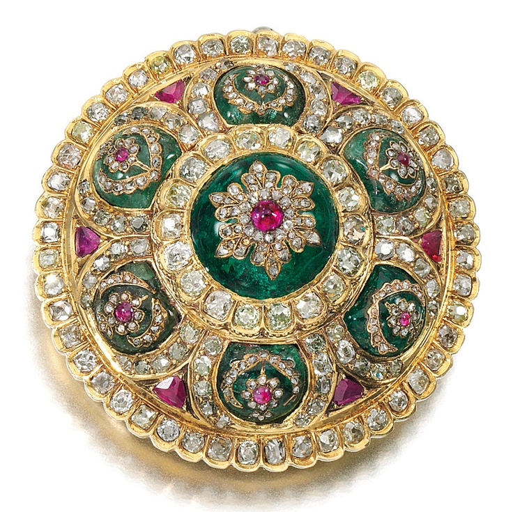 GEM SET AND DIAMOND BROOCH, LATE 19TH CENTURY, POSSIBLY TURKISH.  Of bombé cluster design, set with cabochon emeralds, inset with gemstones including cabochon and faceted rubies, cushion-shaped, single-cut and rose diamonds, detachable brooch fitting, French import marks.