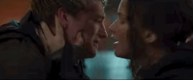 """AND PEETA'S CRYING AND KATNISS IS KISSING HIM, I CAN'T. 