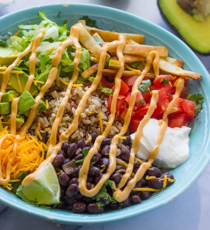 If you're looking for a delicious meal that will keep you satisfied, here are 15 grain bowl recipes to keep handy. They're always loaded with complex carbs, lean proteins, and lots and lots of veggies—aka the satisfying nutrient trio.