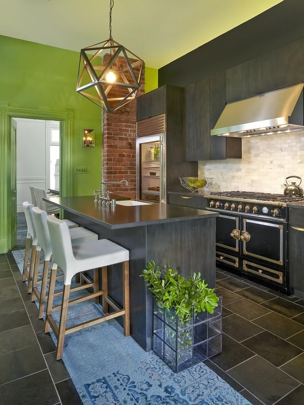 Cool slate grays anchor this kitchen by Susan Diana Harris, ASID, while brighter greens steal the show both indoors and out. The walls are painted Behr's Fresh Grass (color #426), and the ceiling is Benjamin Moore's Pale Vista (2029-60).
