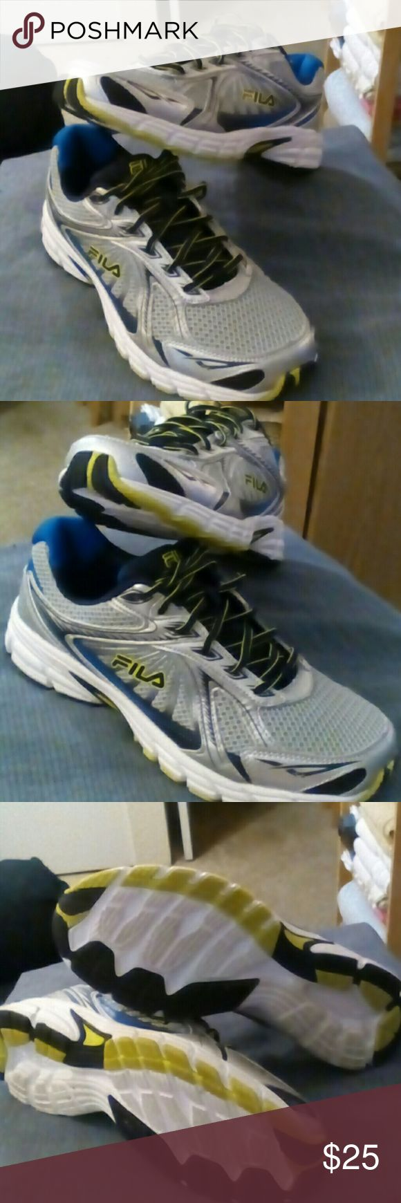 Men's Fila Running Shoes They r in EUC. Worn once and hubby decided their not his style. So I'm selling them.  The colors r cool. Their black, grey, blue and bright neon green. I'm sure ur going to love them. Fila Shoes Athletic Shoes