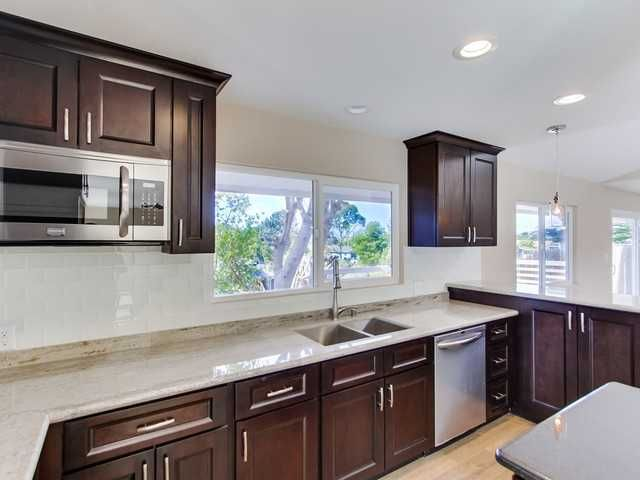 Dark Cabinets With White Glass Subway Tile Backsplash And
