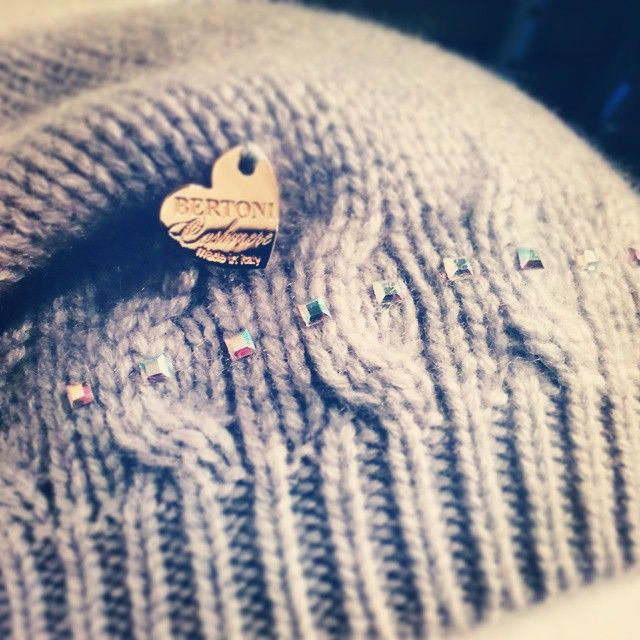 Details of pure cashmere cap with a interlaced design, and square swarovski crystals.