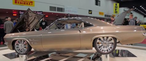 "All About Chip Foose's 1965 Chevy Impala. This wicked Chevrolet is Chip's latest project and as always he has totally nailed it and the ""Impostor"" was awarded with the Ridler at the 2015 Detroit Autorama car show. This custom '65 Impala is actually built over a 2008 Corvette drive train, meaning that the owner can go to any Chevrolet dealership and get it fixed."