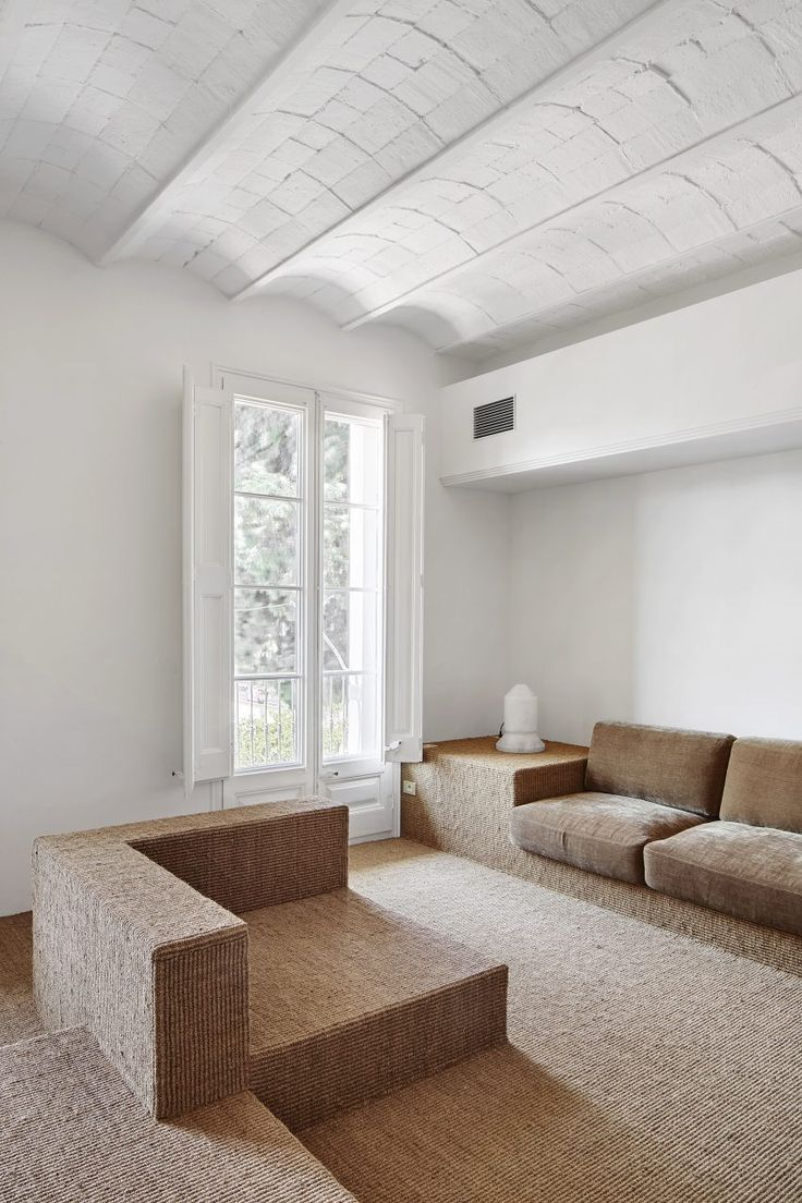 Zigzags and arches feature in renovated Barcelona flat by Arquitectura-G