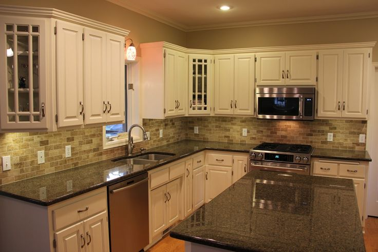 tile backsplashes with granite countertops | Black kitchen granite countertops with tile backsplash and white ...
