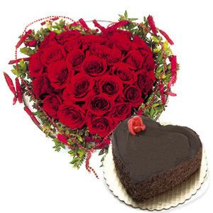 24 red roses in heart shape + 1 kg heart shape chocolate cake.