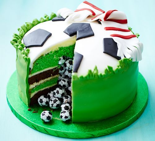 Surprise piñata football cake