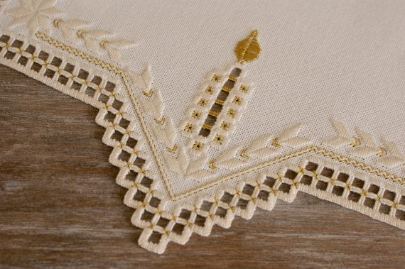 Christmas Hardanger Centerpiece Doily This Centerpiece was hand stitched by my mother on beige villela and cotton material with beige DMC perle cotton. The doily has gold candles and some gold details. The measures are 15,75 x 15,75 (40 x 40 cm). The doily fits all furniture styles and looks very decorative on a table. If youre looking for a gift for someone who is hard to find things for, this doily would be a perfect choice! Quality piece crafted with pride and comes from a smoke fee&#x...
