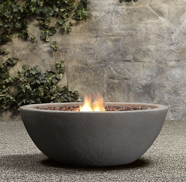 This look great by the pool.  Provides lights at night! Lava Rock Propane Fire Bowl | Fire Tables & Columns | Restoration Hardware