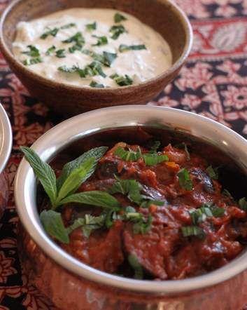 Borani banjan - Spicy eggplant and tomato, served with yoghurt and mint sauce.