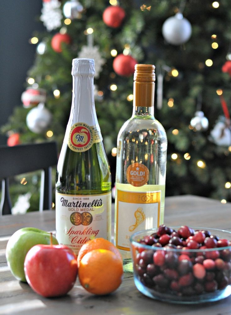 Holiday Sangria - 1 bottle white wine, 1 bottle sparkling apple cider, 2 clementines, 1 Granny Smith apple, 1 Gala apple, 2 cups cranberries. Combine, chill, serve.